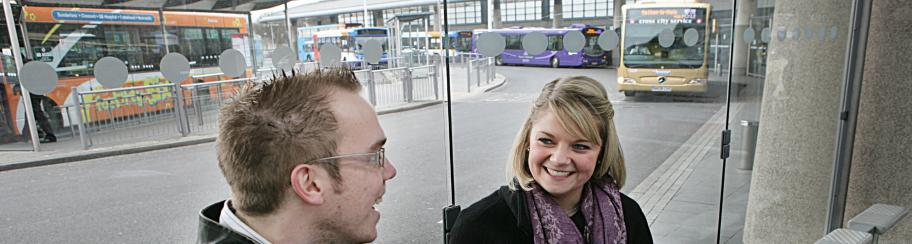 Passengers waiting at a bus station