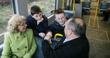 Grandparents and grandkids use the Metro