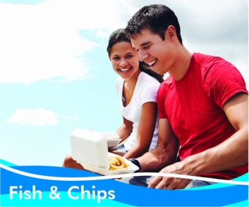 Couple eating fish and chips