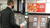 A passenger opens a ticket gate with a smart phone