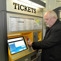 man using ticket machine