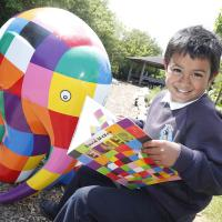 A Year 4 pupil from Hadrian Road Primary School with the Elmer the Elephant sculpture