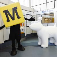 metro logo next to snow dog sculpture