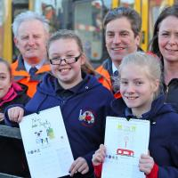 children showing drawings of level crossing safety posters