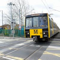 metro train at kingston park level crossing