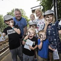 Children at Kingston Park Metro station with the new Metro adventure book