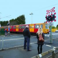 metro train at level crossing