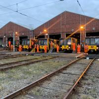 Metro Depot staff line up in front of the fleet for clap for carers