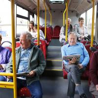 Generic images of bus users