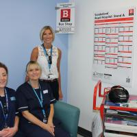 Sunderland Royal Nusring staff with the replica bus stop in the hospital