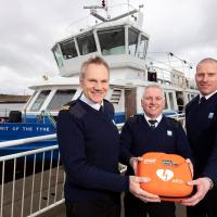 Ferry crew with the new defibrillator