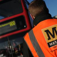 metro staff next to a bus