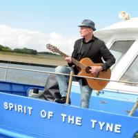 A musician on the Shields Ferry