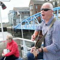 man busking on shields ferry