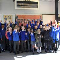 St Wilfrid's pupils with their artwork at Gateshead Stadium Metro station