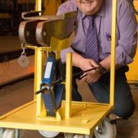 Alan Jones with one of the lifting devices he designed.