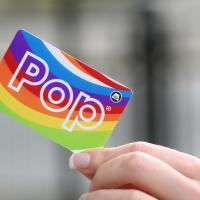 hand holding a Pop card
