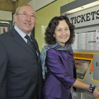 people at new ticket machine