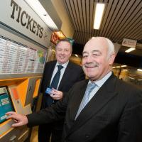 two men at ticket machine