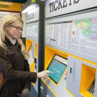 woman at new ticket machine
