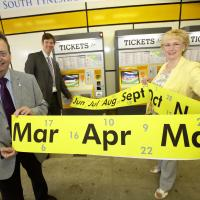 councillors hold up a calendar emerging from a ticket machine (publicity shot)