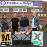 Nexus staff hand over donations to Hebburb foodbank volunteers