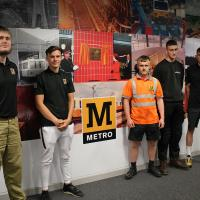 Rail Academy students with the Metro wall display