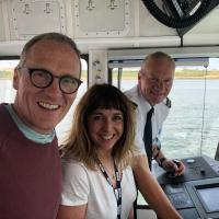 BBC Newcastle presenters Alfie Joey and Anna Foster on board the Shields Ferry Spirit of the Tyne with Ferry Skipper Chris McGuinness