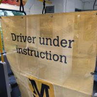 Metro driver under instruction banner