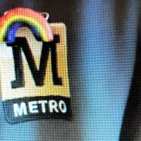 The rainbow badge that was left for the Metro drivers by a passenger - pinned too the Metro logo on his lapel