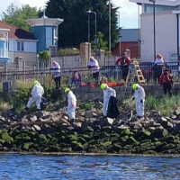 Volunteers cleaning the riverbank next to South Shields ferry landing