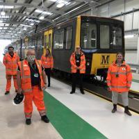 Staff with the new Metero train in the new Howdon depot