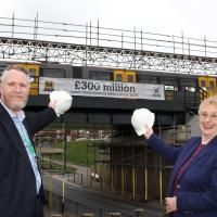 Nexus Finance Director and Cllr Hobson with Beach Road Metro bridge in Tynemouth