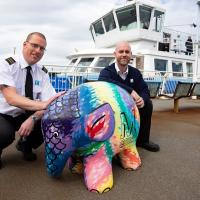 Ferry crew with Elmer the Elephant sculpture