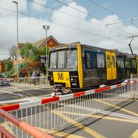 A Metro train at East Boldon level crossing