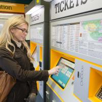 A person using a Metro ticket machine
