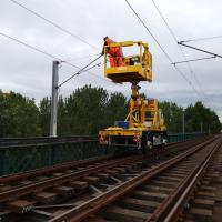 Photo of staff working on Metro overhead power lines