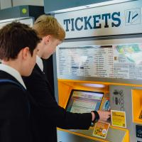 Pupils at Metro ticket machines topping up a Pop blue smartcard