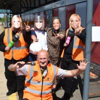 Metro staff with Spice Girls masks on at Stadium of Light Metro station