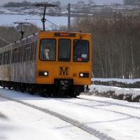 A Metro train in snowy scene