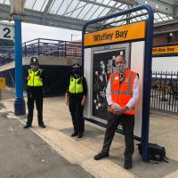 Staff and police at Whitley Bay Metro station